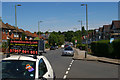 TQ2389 : Finchley Lane, Hendon, with advertisement by Christopher Hilton