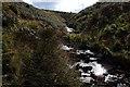 SD9914 : Stream at Rocking Stone below the M62 by Mick Garratt