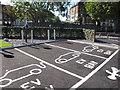TQ2081 : Electric car charging posts at McDonald's North Acton by David Hawgood