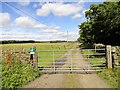 NZ0552 : Farm track gateway by Robert Graham