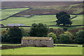 SE0198 : Barn or barns astride dry stone wall by Trevor Littlewood