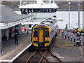 NG7627 : A train at Kyle railway station by John Lucas