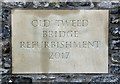 NT4832 : An inscribed stone at Old Tweed Bridge by Walter Baxter