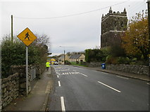 R7624 : Main Street (R513) in Ballylanders near its derelict church by Peter Wood