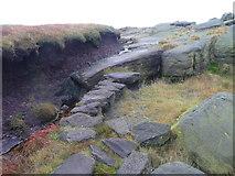 SD9716 : Causeway on the Pennine Way near the summit of Blackstone Edge by Humphrey Bolton