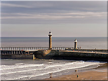 NZ8911 : Piers and Lighthouses at Whitby Harbour by David Dixon