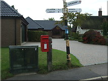TG3204 : Elizabeth II postbox on The Street, Rockland St Mary by JThomas