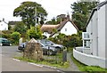 SW7624 : Pretty cottage and the village well, Manaccan, Cornwall by Derek Voller