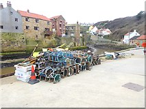 NZ7818 : Lobster pots on the quayside by Oliver Dixon