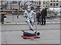 TQ3080 : Painted figure in Trafalgar Square by Marathon
