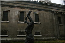 TQ2982 : View of a statue in the grounds of St. Pancras Church from Euston Road by Robert Lamb