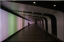 TQ3083 : View along the light tunnel leading into King's Cross St Pancras tube station by Robert Lamb