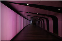 TQ3083 : View along the light tunnel leading into King's Cross St Pancras tube station #2 by Robert Lamb