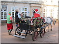 SX8963 : Santa, elf & horse-drawn carriage, Cockington by David Hawgood