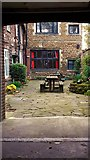 TF6120 : Through an arch off St Ann's Street by Chris Brown