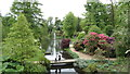 SJ8772 : Henbury Hall Gardens near Macclesfield - Lake, fountain & footbridge by Colin Park