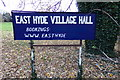 TL1217 : East Hyde Village Hall sign by Adrian Cable