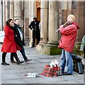 SJ8398 : Busker with dog by Gerald England