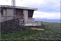 SZ1790 : Disused Coastguard station on Hengistbury Head, with The Needles beyond by David Martin