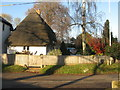 SU3432 : Thatched house at Houghton by M J Richardson