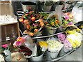 TQ2691 : Display of flowers at Waitrose, North Finchley by David Howard