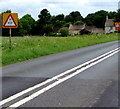 ST9798 : Warning of a low bridge ahead on the A433 towards Cirencester by Jaggery