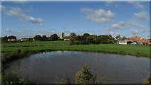 TM4160 : Friston, Suffolk - St Mary the Virgin Church as seen across pond by Colin Park