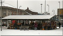 SJ9494 : Market Stall in the snow by Gerald England