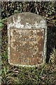 NY3653 : Old Milestone by the A595 by CF Smith