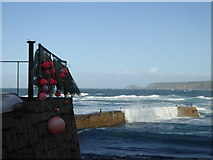 SW3526 : Waves washing over the breakwater at Sennen Cove by Rod Allday