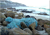 SW3526 : Fishing nets washed up on the rocks at Sennen Cove by Rod Allday