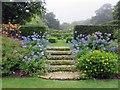 SZ4083 : Steps in the garden at Mottistone Manor by Steve Daniels