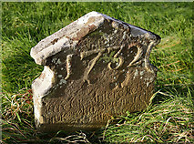 NT8541 : An 18th century gravestone at Lennel Churchyard by Walter Baxter