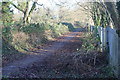 ST1494 : Path between graveyard and school grounds by M J Roscoe