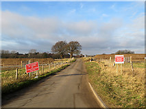 TM2743 : Road signs and construction work on the lane to Newbourne by John Sutton