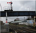 SO3013 : Footbridge and semaphore signal at the southern end of Abergavenny railway station by Jaggery