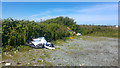 SH2279 : Fly tipping at parking area near Penrhos Feilw, Holy Island, Anglesey by Phil Champion