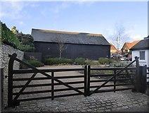 TQ2255 : Walton on the Hill: barn at Pond Farm Close by Stefan Czapski