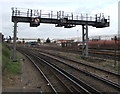 SU6500 : Signal gantry beyond the eastern end of Fratton railway station, Portsmouth by Jaggery