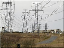 NZ3089 : Power lines from Lynemouth Power Station by Graham Robson