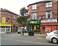 SJ8794 : Shops on Stockport Road by Gerald England