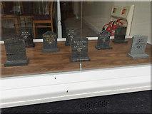 TM0458 : Types of 'granite' in a funeral director's window, Marriotts Walk, Stowmarket by Robin Stott