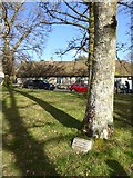 SX7483 : North Bovey village green commemoration of peace by David Smith
