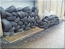 TQ2087 : Tyres outside Grays in Kingsbury by David Howard