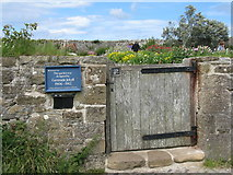 NU1341 : Garden entrance at Lindisfarne by M J Richardson