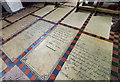 SK8608 : Memorial slabs, All Saints' church, Oakham by J.Hannan