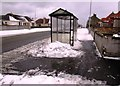 NT3699 : Snow at bus shelter by Bill Kasman