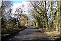 TL1319 : Chiltern Green Road & footpath by Adrian Cable