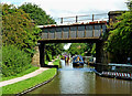 SK2102 : Railway bridge across the canal at Kettlebrook, Staffordshire by Roger  Kidd