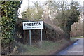 TL1724 : Preston Village Name sign on Back Lane by Adrian Cable